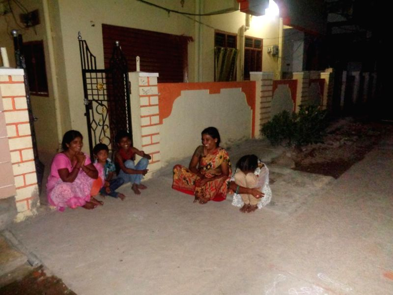 Residents of Nizamabad district of  Telangana come out of their houses amidst rumours of earth quake in the area on Aug 19, 2014.