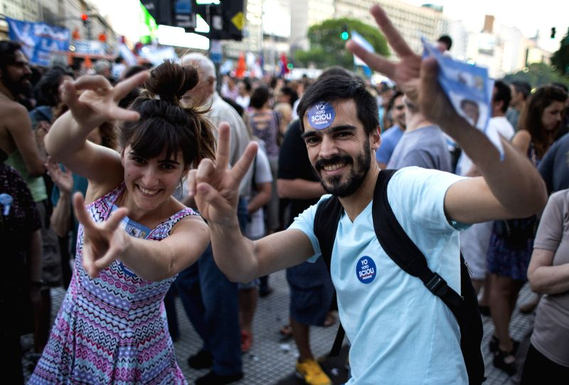Residents take part in a rally in support of the presidential candidate of the ruling party Front for the Victory Daniel Scioli, in Buenos Aires city, capital ...