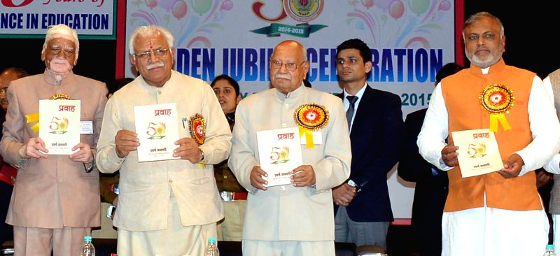 Haryana Chief Minister Manohar Lal Khattar release a book titled `Pravaah` on the occasion of Golden Jubilee celebrations of KLP College in Rewari on Feb. 2, 2015. Also seen Haryana Minister . - Manohar Lal Khattar and Bikram Singh Yadav