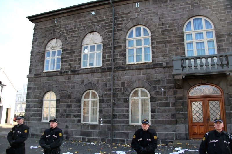 REYKJAVIK, April 5, 2016 - Policemen stand guard in front of the parliament building during a protest in Reykjavik, capital of Iceland, on April 4, 2016. Thousands of Icelanders gathered in front of ... - Sigmundur David Gunnlaugsson