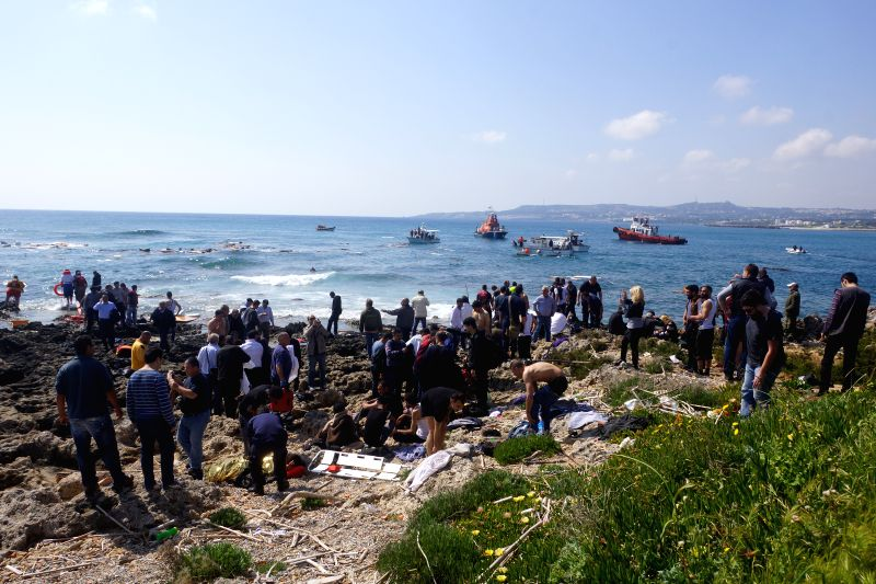 Rescue operations are carried out on Rhodes island, Greece, April 20, 2015. A vessel carrying approximately 200 irregular migrants sank off the coasts of Rhodes ...