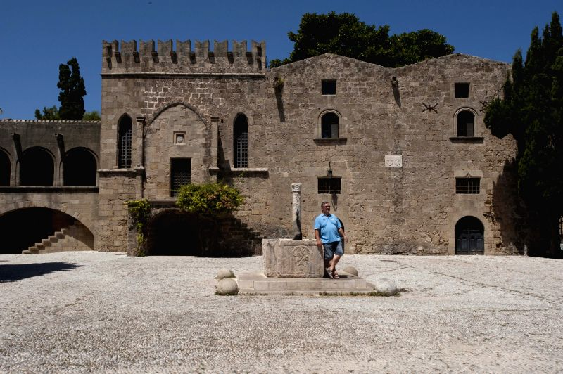 A tourist poses for photos in Medieval City of Rhodes in Rhodes, Greece, on July 12, 2014. The Order of St John of Jerusalem occupied Rhodes from 1309 to 1523 and ...