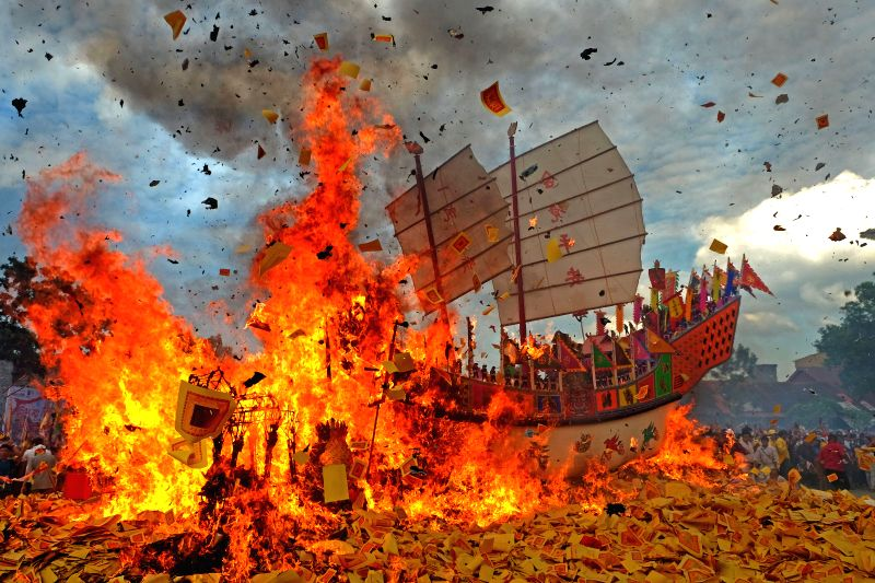RIAU, June 11, 2017 - People participate in Bakar Tongkang or the barge burning tradition at Bagansiapi api in Riau, Indonesia. June 11, 2017.