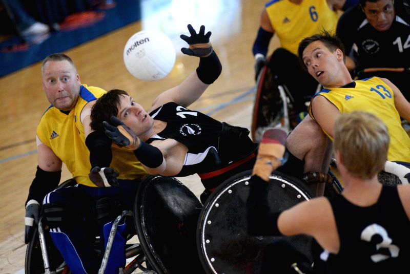 Dan Buckingham (C) of New Zealand battles during match against Sweden at 2014 Canada Cup International Wheelchair Rugby Tournament in Richmond, Canada, June 20, ...
