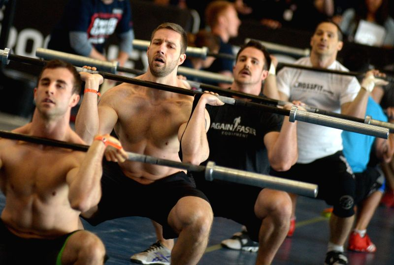 Zack McMillan, Jeremy Edwards, Jeremy Meredith and Mike Eberts (L to R) of Canada compete during opening day of 2014 CrossFit Games Canada on May 9, 2014 in ...