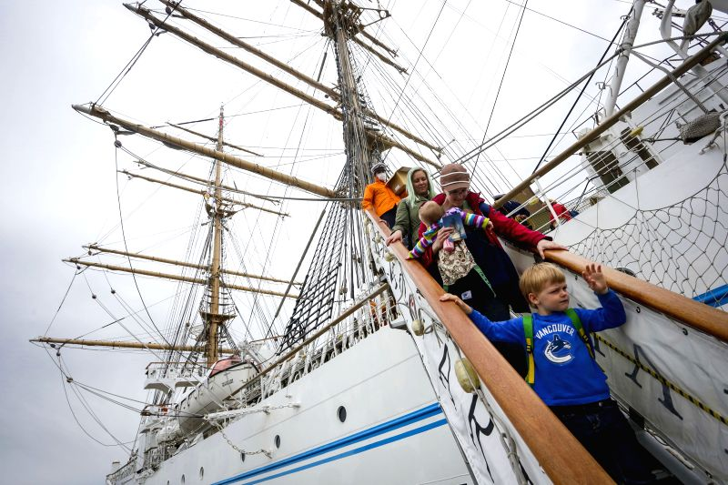 "RICHMOND, May 6, 2017 - Visitors walk down from a stair in a tall ship during the ""Ships to Shore"" Festival at Steveston Village in Richmond, Canada, May 5, 2017. The 3-day ""Ships to ..."