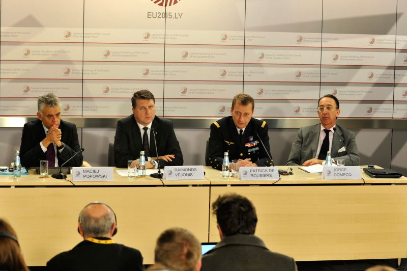 Latvian Defense Minister Raimonds Vejonis (2nd L) and Maciej Popowski, Deputy Secretary-General of the European External Action Service(1st L) attend a press ... - Raimonds Vejonis