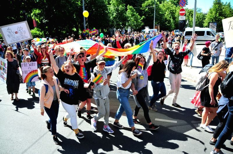 RIGA, June 9, 2018 - People attend the Baltic Pride parade in downtown Riga, Latvia, on June 9, 2018. Around 8,000 people gathered in a park in downtown Riga on Saturday to march in the Baltic Pride ...