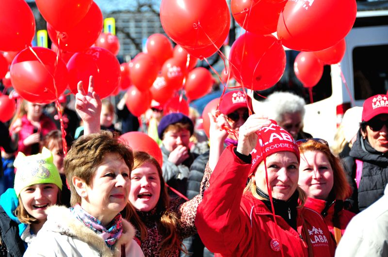 RIGA, May 1, 2017 - People hold balloons in their hands during a parade to celebrate the International Labor Day in Riga, Latvia, on May 1, 2017.