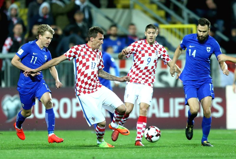 RIJEKA, Oct. 7, 2017 - Mario Mandzukic (2nd L) and Andrej Kramaric (2nd R) of Croatia vie with Rasmus Schuller (1st L) and Tim Sparv of Finland during 2018 FIFA World Cup Russia qualifiers match ...