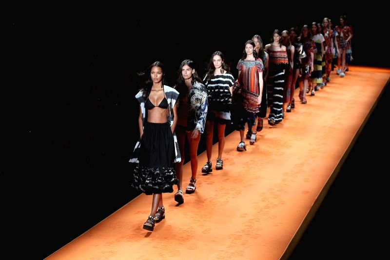 Models present creations of  Oh Boy brand during Fashion Rio Summer 2015 in Rio de Janeiro, Brazil, on April 9, 2014. Photo: (Xinhua/Xu Zijian)