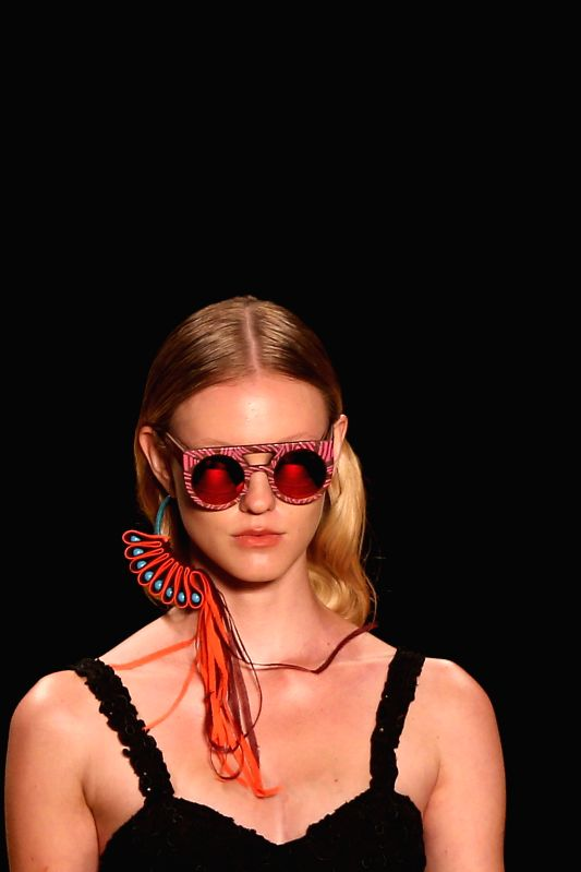 A model wearing sunglasses presents a fashion creation of Salinas brand on a show during the Fashion Rio event in Rio de Janeiro, Brazil, on April 10, 2014.