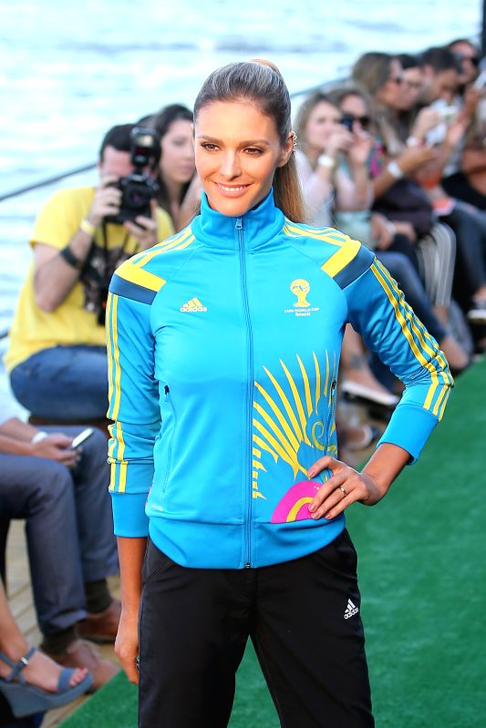 Brazilian model Fernanda Lima presents the uniforms designed for FIFA World Cup volunteers on a fashion show during Fashion Rio event in Rio de Janeiro, ... - Fernanda Lima