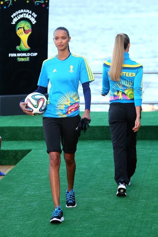 Brazilian model Lais Ribeiro (L) presents the uniform designed for FIFA World Cup volunteers on a fashion show during Fashion Rio event in Rio de Janeiro, .. - Lais Ribeiro