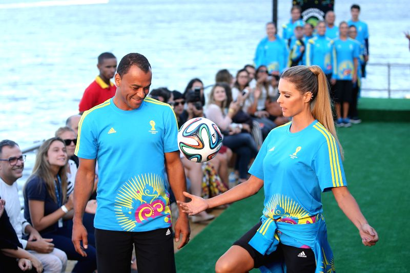 Former Brazilian football player Cafu (L) and Brazilian model Fernanda Lima present the uniforms designed for FIFA World Cup volunteers on a fashion show ... - Fernanda Lima