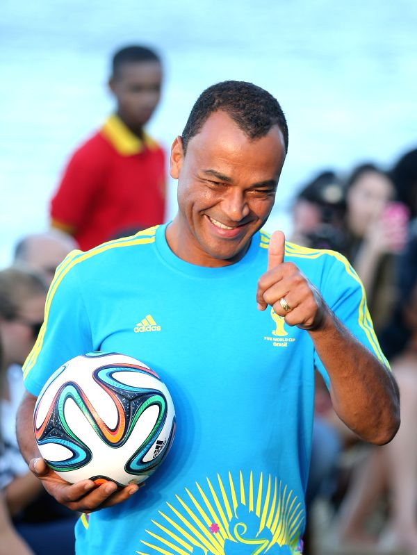 Former Brazilian football player Cafu presents the uniform designed for FIFA World Cup volunteers on a fashion show during Fashion Rio event in Rio de ...