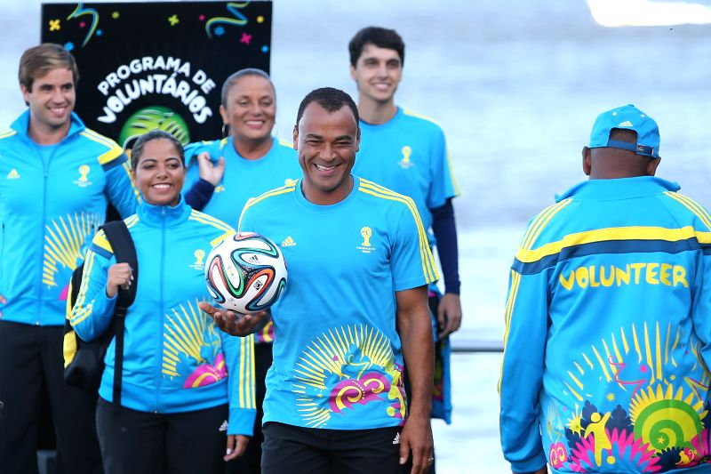 Former Brazilian football player Cafu (C) presents the uniforms designed for FIFA World Cup volunteers on a fashion show during Fashion Rio event in Rio de .