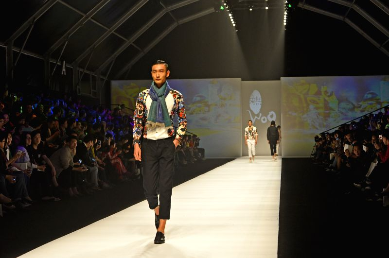 A model presents fashion creation of Triya brand on a fashion show of Fashion Rio event in Rio de Janeiro, Brazil, on April 11, 2014. Fashion Rio summer ...