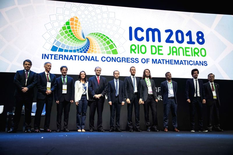 RIO DE JANEIRO, Aug. 1, 2018 - The Fields Medal winners pose for photos with some attendees during the opening ceremony of the 2018 International Congress of Mathematicians in Rio de Janeiro, Brazil, ...