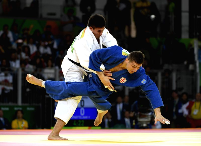 RIO DE JANEIRO, Aug. 10, 2016 - Baker Mashu (top) of Japan competes with Varlam Liparteliani of Georgia during the men's 90KG judo final at the 2016 Rio Olympic Games in Rio de Janeiro, Brazil, on ...