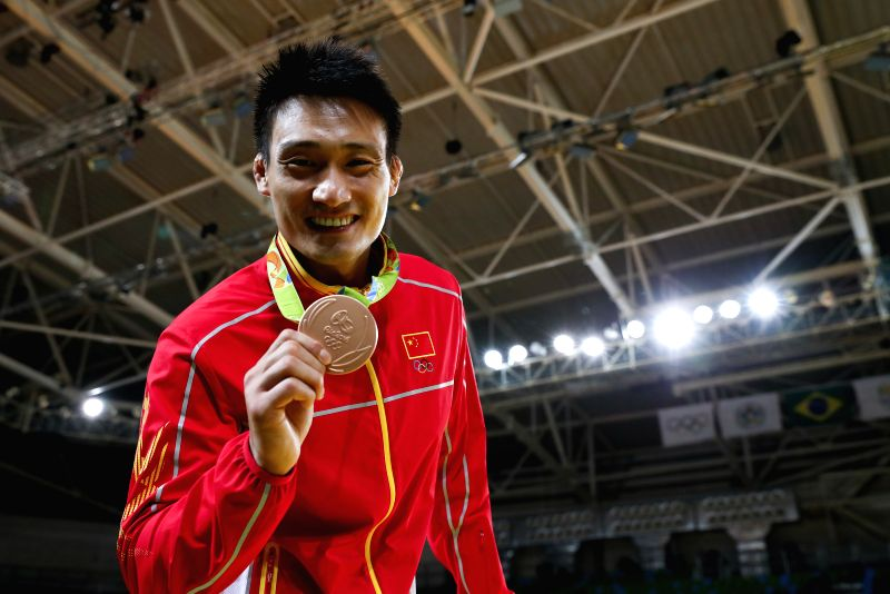 RIO DE JANEIRO, Aug. 10, 2016 - Cheng Xunzhao of China shows his medal during the awarding ceremony for men's -90kg category of judo at the 2016 Rio Olympic Games in Rio de Janeiro, Brazil, on Aug. ...