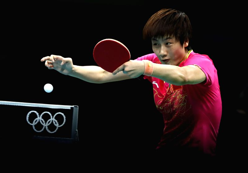 RIO DE JANEIRO, Aug. 10, 2016 - China's Ding Ning returns the ball against her compatriot Li Xiaoxia during the women's singles gold medal match of table tennis at the 2016 Rio Olympic Games in Rio ...