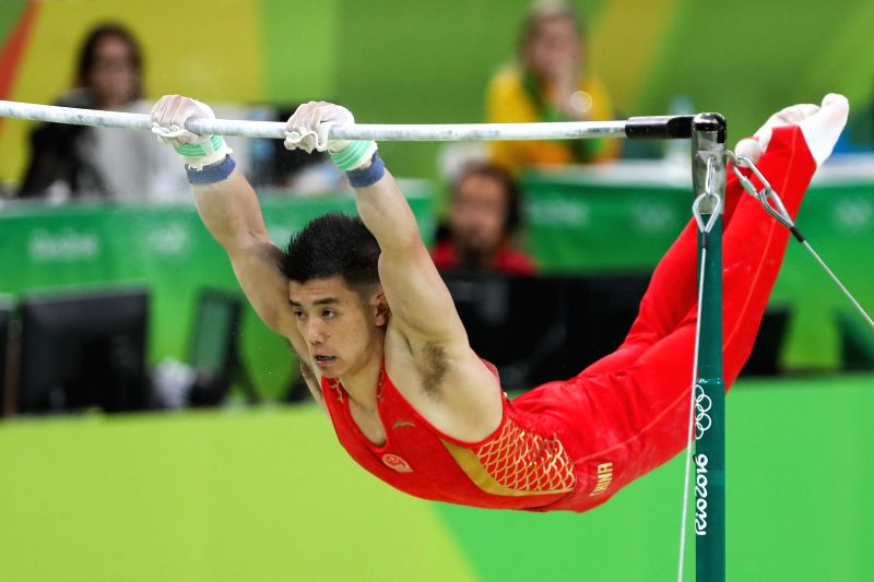 RIO DE JANEIRO, Aug. 10, 2016 - China's Lin Chaopan competes in horizontal bar event during the men's indivudual all-around final of Artistic Gymnastics at the 2016 Rio Olympic Games in Rio de ...