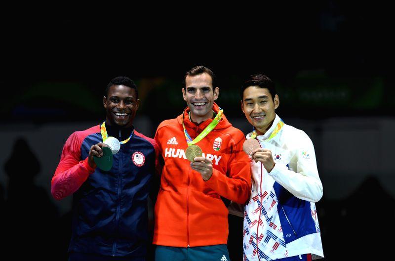 RIO DE JANEIRO, Aug. 10, 2016 - Gold medalist Aron Szilagyi (C) of Hungary, silver medalist Daryl Homer (L) of the United States of America, bronze medalist Kim Junghwan of South Korea show thier ...