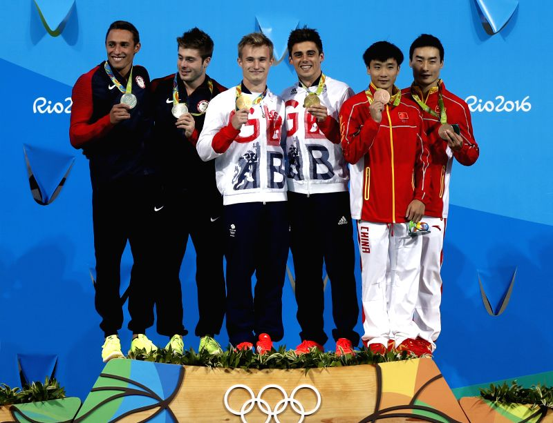 RIO DE JANEIRO, Aug. 10, 2016 - Gold medalists Britain's Jack Laugher and Chris Mears (C) , silver medalists Mike Hixon and Sam Dorman  (L) of the Unites States of America, bronze medalists China's ...