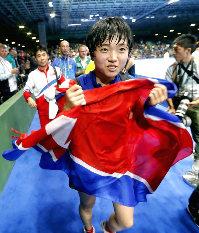 RIO DE JANEIRO, Aug. 10, 2016 - Kim Song I of the Democratic People's Republic of Korea (DPRK) celebrates for winning against Japan's Ai Fukuhara during the women's singles bronze madel match of ...