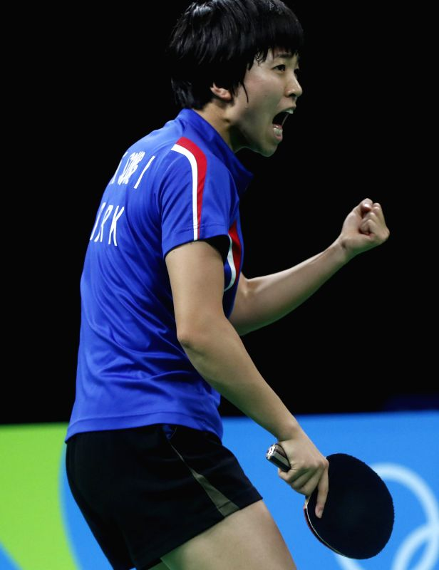 RIO DE JANEIRO, Aug. 10, 2016 - Kim Song I of the Democratic People's Republic of Korea (DPRK) celebrates after scoring against Japan's Ai Fukuhara during the women's singles bronze madel match of ...