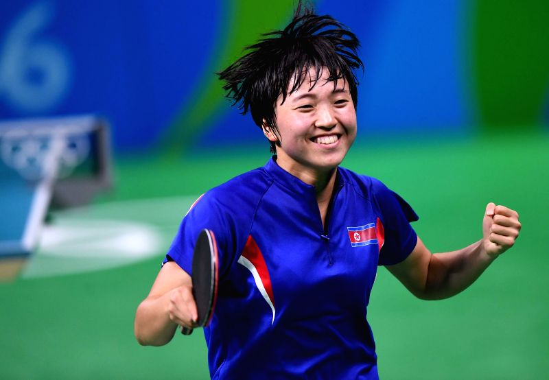 RIO DE JANEIRO, Aug. 10, 2016 - Kim Song I of the Democratic People's Republic of Korea (DPRK) celebrates for wining over Japan's Ai Fukuhara during the women's singles bronze madel match of table ...