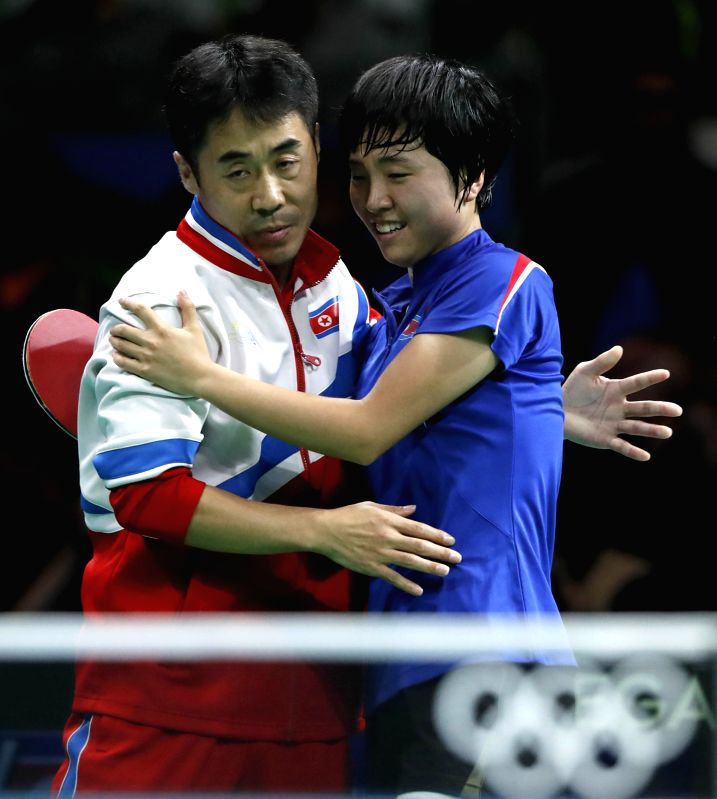 RIO DE JANEIRO, Aug. 10, 2016 - Kim Song I (R) of the Democratic People's Republic of Korea (DPRK) celebrates with her coach after winning over Japan's Ai Fukuhara during the women's singles bronze ...