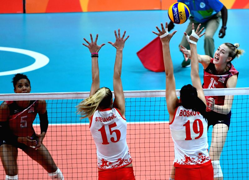 RIO DE JANEIRO, Aug. 10, 2016 - Kimberly Hill (R) of the Unites States of America spikes the ball against Serbia during a women's preliminary match of volleyball at the 2016 Rio Olympic Games in Rio ...