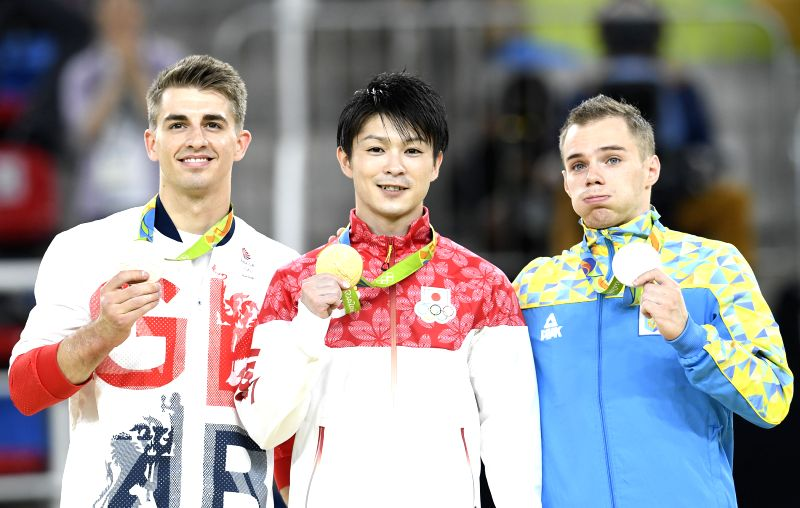 RIO DE JANEIRO, Aug. 10, 2016 - Kohei Uchimura of Japan (C), Oleg Verniaiev of Ukraine (R) and Max Whitlock of Great Britain show medals at the awarding ceremony of men's individual all-around final ...
