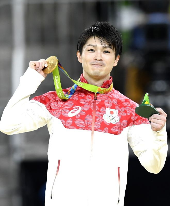 RIO DE JANEIRO, Aug. 10, 2016 - Kohei Uchimura of Japan shows the gold medal at the awarding ceremony of men's individual all-around final at the 2016 Rio Olympic Games in Rio de Janeiro, Brazil, on ...