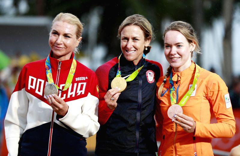 RIO DE JANEIRO, Aug. 10, 2016 - Kristin Armstrong of the United States (C), Olga Zabelinskaya of Russia (L) and Anna van der Breggen of Netherlands celebrate at the awarding ceremony of the women's ...