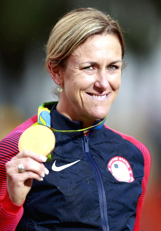 RIO DE JANEIRO, Aug. 10, 2016 - Kristin Armstrong of the United States celebrates at the awarding ceremony of the women's individual time trial of cycling road at the 2016 Rio Olympic Games in Rio de ...