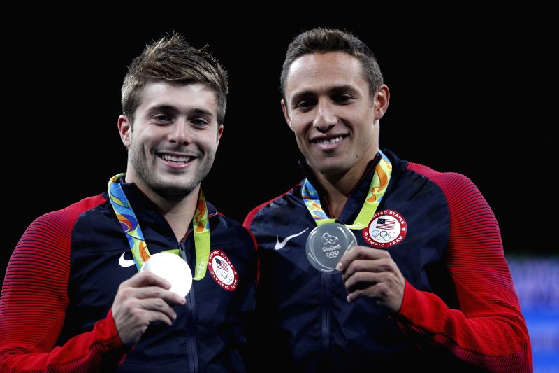 RIO DE JANEIRO, Aug. 10, 2016 - Sam Dorman and Mike Hixon of the United States show the silver medal at the awarding ceremony of the men's synchronised 3m springboard diving final at the 2016 Rio ...