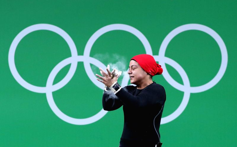 RIO DE JANEIRO, Aug. 10, 2016 - Sara Ahmed of Egypt celebrates during the women's 69KG weightlifting group A final at the 2016 Rio Olympic Games in Rio de Janeiro, Brazil, on Aug. 10, 2016. Sara ...