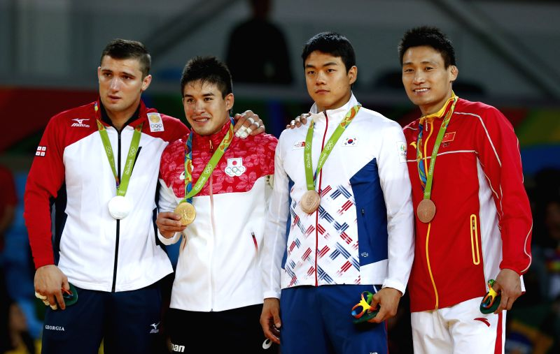 RIO DE JANEIRO, Aug. 10, 2016 - Varlam Liparteliani of Georgia,Baker Mashu of Japan, Gwak Donghan of South Korea and Cheng Xunzhao of China (from L to R) attend the awarding ceremony of the men's ...