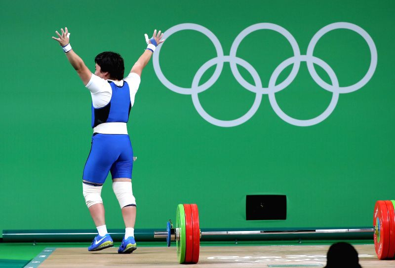 RIO DE JANEIRO, Aug. 10, 2016 - Zhazira Zhapparkul of Kazakhstan celebrates during the women's 69KG weightlifting group A final at the 2016 Rio Olympic Games in Rio de Janeiro, Brazil, on Aug. 10, ...