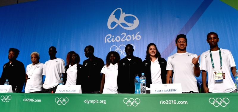 RIO DE JANEIRO, Aug. 2, 2016 - Athletes of Olympic Refugee Team take a photo after a press conference of the Refugee Olympics Team at the Main Press Center (MPC) of Rio Olympic Games in Rio de ...
