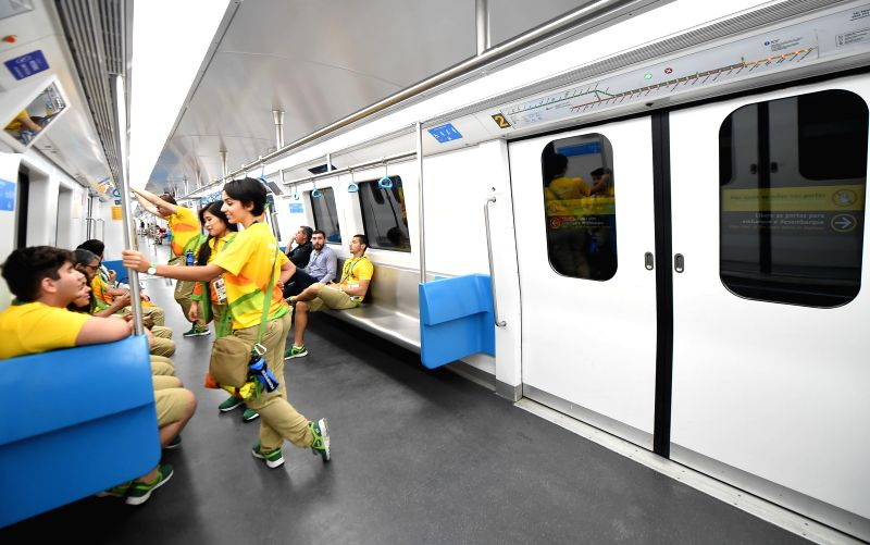 RIO DE JANEIRO, Aug. 2, 2016 - Olympic volunteers take the metro line 4 in Rio de Janeiro, Brazil, on Aug. 1, 2016. Rio's new metro Line 4, which will be one of the main enduring legacy's of the ...