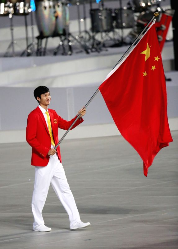 RIO DE JANEIRO, Aug. 3, 2016 - File photo taken on Sept. 19, 2014 shows Lei Sheng, the flag bearer of the Chinese delegation parading into the stadium during the opening ceremony of the 17th Asian ...