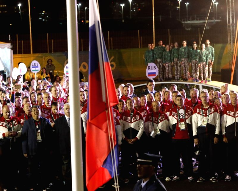 RIO DE JANEIRO, Aug. 3, 2016 - Members of the delegation of Russia attend the flag-raising ceremony at the Olympic Village in Rio de Janeiro, Brazil, on Aug. 3, 2016.