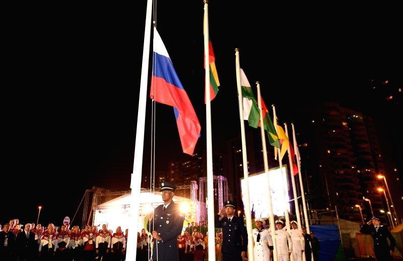 RIO DE JANEIRO, Aug. 3, 2016 - The national flag of Russia is raised during the flag-raising ceremony at the Olympic Village in Rio de Janeiro, Brazil, on Aug. 3, 2016.