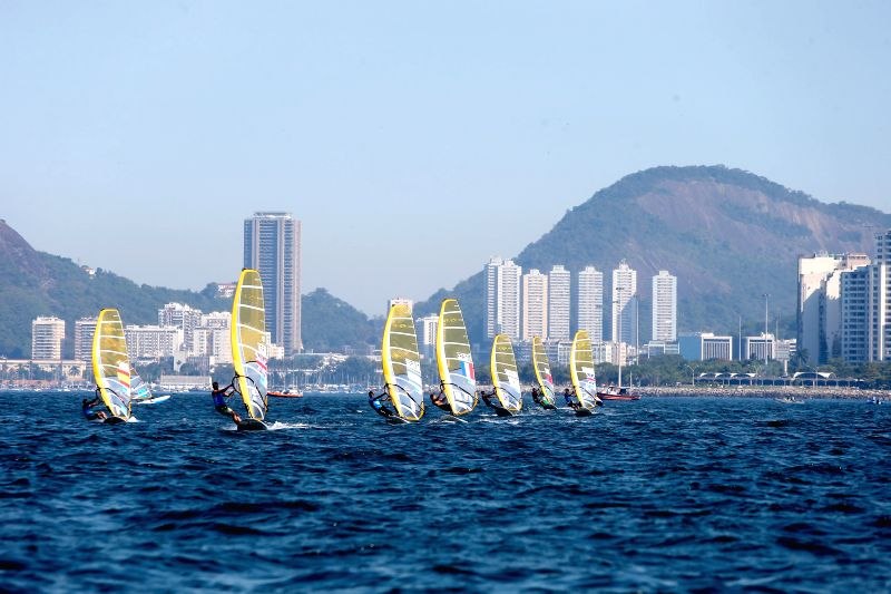 Athletes compete during men's RS:X class match at the Guanabara Bay in Rio de Janeiro, Brazil, Aug. 3, 2014. Aquece Rio International Sailing Regatta 2014, ...