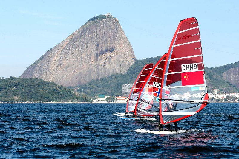 Chinese athlete Sun Jiali (front) competes during women's RS:X class match at the Guanabara Bay in Rio de Janeiro, Brazil, Aug. 3, 2014. Sun Jiali ranked the .