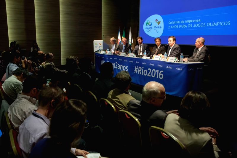 Delegates attend a press conference marking the two-year countdown of the opening of Rio 2016 Olympic Games in Rio de Janeiro, Brazil, Aug. 4, 2014. ...